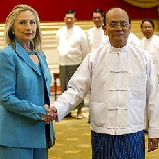 U.S. Secretary of State Hillary Clinton shakes hands with Myanmars President Thein Sein during a meeting in Naypyitaw, on Dec. 1, 2011. /Reuters