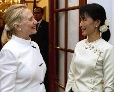 U.S. Secretary of State Hillary Clinton and Aung San Suu Kyi talk prior to dinner at the U.S. Chief of Mission residence in Rangoon, on Dec. 1, 2011. /AP