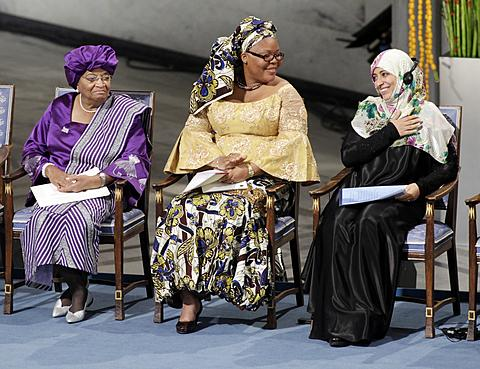 Nobel Peace Prize winners Liberian president Ellen Johnson-Sirleaf (left), Liberian peace activist Leymah Gbowee (center), and Tawakkol Karman of Yemen (right) take the stage at City Hall in in Oslo, Norway on Dec. 10, 2011. /AP