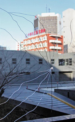 A window at the Korean Embassy in Beijing is cracked by small projectile apparently fired from an air gun on Tuesday. /Yonhap
