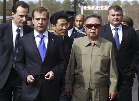 North Korean leader Kim Jong-il (right) and Russian President Dmitry Medvedev walk during a meeting an a military garrison, outside Ulan-Ude, on Aug. 24, 2011. /AP