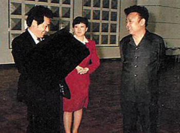 The Fujimotos meet Kim Jong-il (file photo).