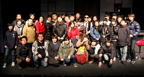 Students and teachers at Gwangju Inhwa School pose at a theater in Seoul during their visit to Seoul in December 2011. /Courtesy of Samgeori Pictures