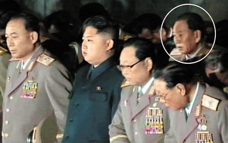 Gen. Kim Yong-chol (in circle), the head of North Koreas General Reconnaissance Bureau, pays respects to the regimes late leader Kim Jong-il on Nov. 24, 2011. /[North] Korean Central News Agency