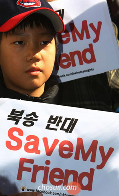 A child holds a picket sign against Chinas repatriation of North Korean defectors in front of the Chinese Embassy in Seoul on Monday.