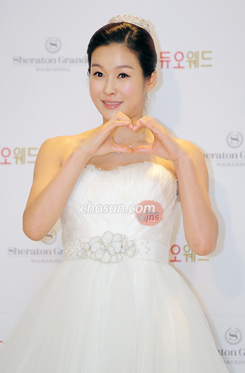 TV personality Hyun Young poses before her wedding at a hotel in Seoul on Sunday.