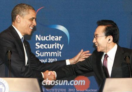 President Lee Myung-bak shakes hands with U.S. President Barack Obama during a joint press conference following their meeting at Cheong Wa Dae in Seoul on Sunday, on the eve of the 2012 Seoul Nuclear Security Summit.