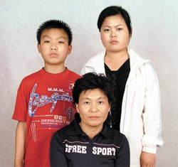 Three family members of a South Korean prisoner of war who arrived in South Korea from China on Sunday pose in this picture taken in June 2009, just before they entered the South Korean Consulate in Beijing to seek refugee. /Courtesy of Family Assembly Abducted to North Korea 