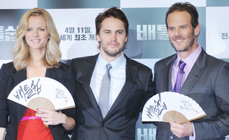 From left, Brooklyn Decker, Taylor Kitsch and Peter Berg