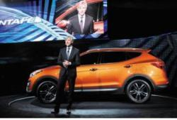John Krafcik, CEO of Hyundai Motor America, unveils the new Santa Fe at the New York Motor Show. /Courtesy of Hyundai Motor