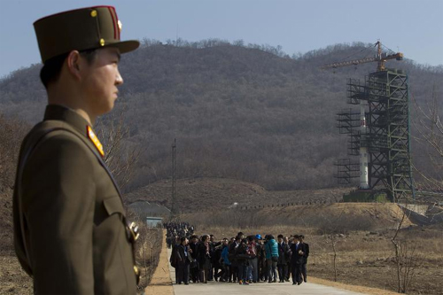 Foreign correspondents look around a missile launch site in Tongchang-ri, North Pyongyang Province, North Korea on Sunday. /AP-Newsis