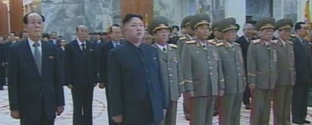 North Korean new leader Kim Jong-un pays tribute to his late father Kim Jong-il and grandfather Kim Il-sung at the Kumsusan Memorial Palace after being named first secretary of the Workers Party in Pyongyang on Wednesday. /[North] Korean Central TV-Yonhap