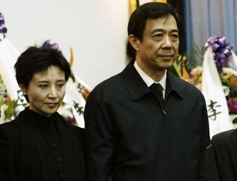 Chinas former Chongqing Municipality Communist Party Secretary Bo Xilai (right) and his wife Gu Kailai in Beijing (file photo) /Reuters