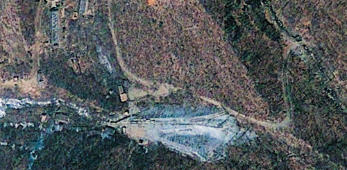 This April 18, 2012 satellite image provided by GeoEye appears to show a train of mining carts, at the lower center of the frame, and other preparations underway at North Koreas Punggye-ri nuclear test site, according to analysis by the U.S.-Korea Institute at Johns Hopkins School of Advanced International Studies. /Courtesy of 38north.org