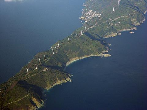 Wind turbines stand along the 50-kilometer (31-mile)-long Sadamisaki Peninsula in Ehime Prefecture, western Japan, which will now become more important as Japan shuts down its last operating nuclear power reactor on Dec. 2, 2011 (file photo). /AP