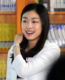 Kim Yu-na speaks to students as a teaching assistant during a class at Jinseon Girls High School in Seoul on Tuesday.