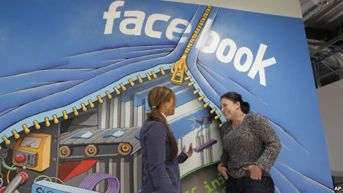 Two workers inside of Facebook headquarters in Menlo Park, California /AP