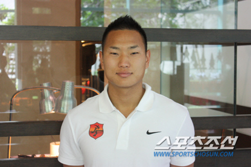 Jong Tae-se poses for a photo ahead of a luncheon organized on the sidelines of the second Asian Dream Cup at a hotel in Bangkok on Wednesday.