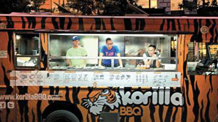 Employees of Korilla BBQ stand in its food truck. /Courtesy of Korilla BBQ co-founder Paul Lee