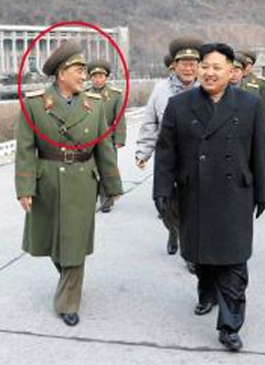 Kim Rak-gyom (in red circle), the new head of North Koreas Strategic Rocket Force, walks with North Korean leader Kim Jong-un (right). /Yonhap