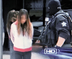 In this TV image grab, police arrest sex workers in Harris County in Houston, Texas in early May. /Courtesy of ABC 13.