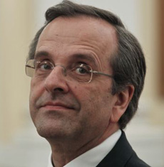 Newly appointed Greek Prime Minister Antonis Samaras smiles before a swearing in ceremony at the presidential palace in Athens on June 20, 2012. /Reuters