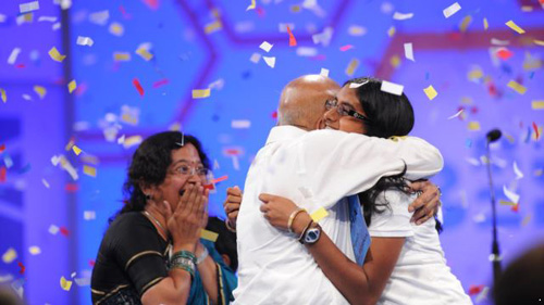 Snigdha Nandipati celebrates her spelling bee victory with her grandparents, Mallikarjunarao and Rajeswari Chalavadi.
