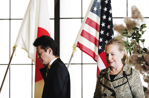 U.S. Secretary of State Hillary Clinton (right) and Japans Foreign Minister Koichiro Gemba leave after a joint press conference at the Iikura Guest House in Tokyo on Sunday. /Reuters-Newsis