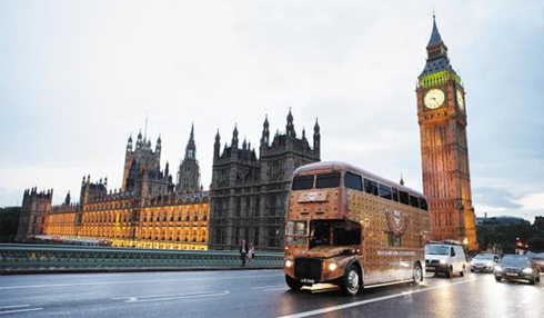 Emblazoned with the Cognac Visetos logo and monograms of the German fashion brand MCM, a double-decker bus passes by Big Ben and the Houses of Parliament in London on Monday (local time). /Courtesy of MCM