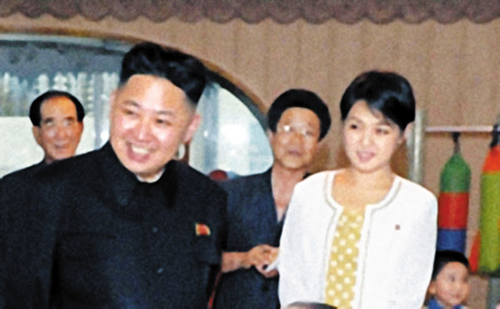 North Korean leader Kim Jong-un and a woman believed to be his wife smile during their visit to a kindergarten in Pyongyang on Sunday. /[North] Korean Central TV-Yonhap