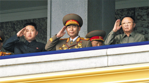 Ri Yong-ho, the chief of the North Korean Armys General Staff, stands between then leader Kim Jong-il (right) and his son Jong-un during a military parade marking the 65th anniversary of the Workers Party in October 2010. /KCNA-Yonhap 