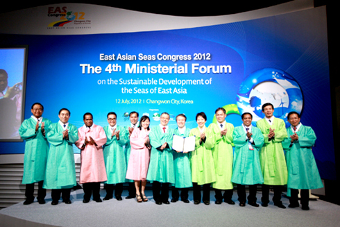 Ministers in Korean traditional dress pose at the ministerial forum of the East Asian Seas Congress 2012.