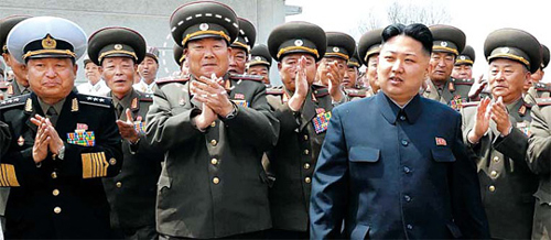 High-ranking North Korean military officials including Hyon Yong-chol (in circle) welcome leader Kim Jong-un as he inspects a military drill marking the 80th anniversary of the founding of the Peoples Army in April. /[North] Korean Central News Agency-Yonhap
