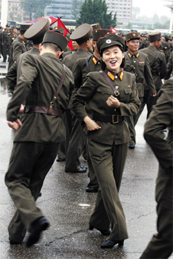North Korean soldiers dance in the plazas of Pyongyang on Wednesday after leader Kim Jong-un was given the title of marshal. /AP-Yonhap