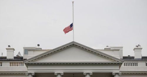 A U.S. flag is seen at half-staff over the White House in Washington on July 20, 2012. President Barack Obama ordered the flag to be lowered in the aftermath of the tragic mass shooting at a movie theater in Aurora, Colorado. /AP