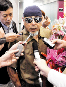 Late North Korean leader Kim Jong-ils former sushi chef talks to the press at Beijing Capital International Airport on his way to Pyongyang on Saturday. /Kyodo News-Newsis