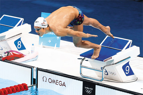 Park Tae-hwan jumps into the water during his first training session at the Olympic Park in London on Sunday.