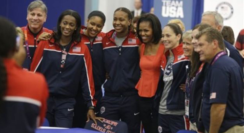 First lady Michelle Obama poses with members of Team USA, 2012 Summer Olympics, London on July 27, 2012. /AP