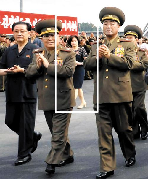 Kim Ok (in white square), the late North Korean leader Kim Jong-ils fourth wife, attends a ceremony to celebrate the completion of an amusement park on Wednesday in this photo revealed the next day by the North Korean Central News Agency. /KCNA-Yonhap