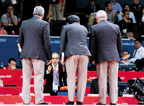 The referee and judges discuss the result of the mens -66kg judo match between Cho Jun-Ho and Japans Masashi Ebinuma in the London 2012 Olympic Games on Sunday at the ExCeL Centre in London.