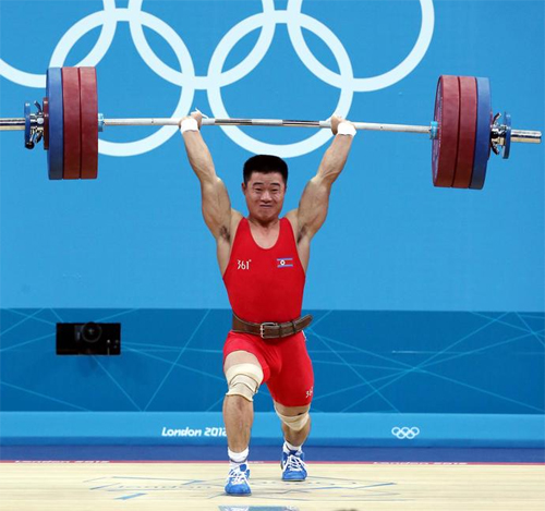 Weightlifter Kim Un-guk competes during mens weightlifting -62kg competition, at London 2012 Olympic Games in London on Monday.