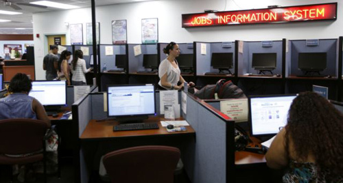 People use computers to look for work at WorkForce One in Hollywood, Florida on Aug. 1, 2012. /AP