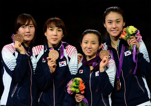 Korean fencers pose with their bronze medals at the victory ceremony for the womens foil team match at the ExCeL Arena during the London 2012 Olympic Games on Thursday. From left, Jeon Hee-sook, Jung Gil-ok, Nam Hyun-hee and Oh Ha-na