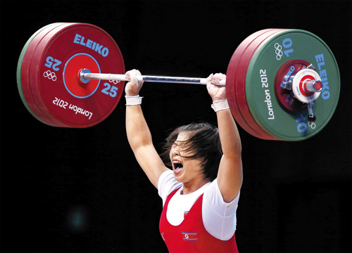 North Koreas Rim Jong-sim competes on the womens 69Kg Group A weightlifting competition at the ExCeL Arena during the London 2012 Olympic Games on Thursday. /Reuters-Yonhap