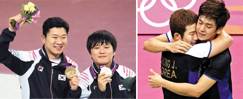 Jin Jong-oh (left) and Choi Young-rae pose with their medals after winning gold and silver in the mens 50-m pistol final at the Royal Artillery Barracks during the London Olympic Games on Sunday. ; Chung Jae-sung (left) and Lee Yong-dae hug while celebrating the victory over Malaysias Koo Kien Keat and Tan Boon Heong in the mens doubles badminton bronze medal match during the 2012 Summer Olympics on Sunday.