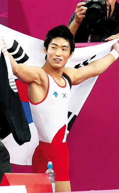 Yang Hak-seon celebrates winning a gold medal in the mens gymnastics vault final at the North Greenwich Arena during the London 2012 Olympic Games on early Tuesday.