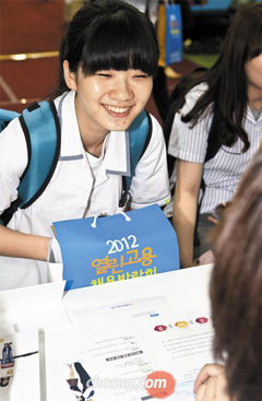 A jobseeker smiles at a job fair at COEX in Seoul.