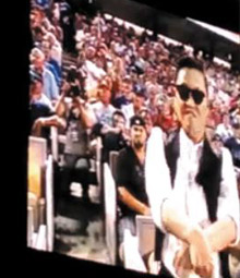 In this captured video footage from YouTube, Psy shows his horse-riding dance during a baseball game in Los Angeles on Monday.