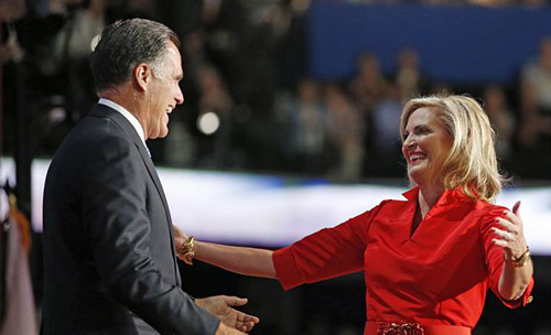 Republican presidential nominee Mitt Romney (left) hugs his wife Ann on stage at the Republican National Convention in Tampa, Florida on Aug. 28, 2012. /AP