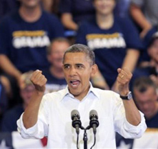 President Barack Obama speaks during a campaign rally at Scott High School, in Toledo, Ohio on Sept. 3, 2012. /Reuters